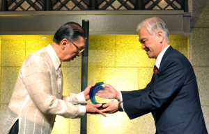 Japan Bank for International Cooperation President and CEO Hiroshi Watanabe presenting the samurai bonds token to Ambassador Domingo Siazon Jr. (left)