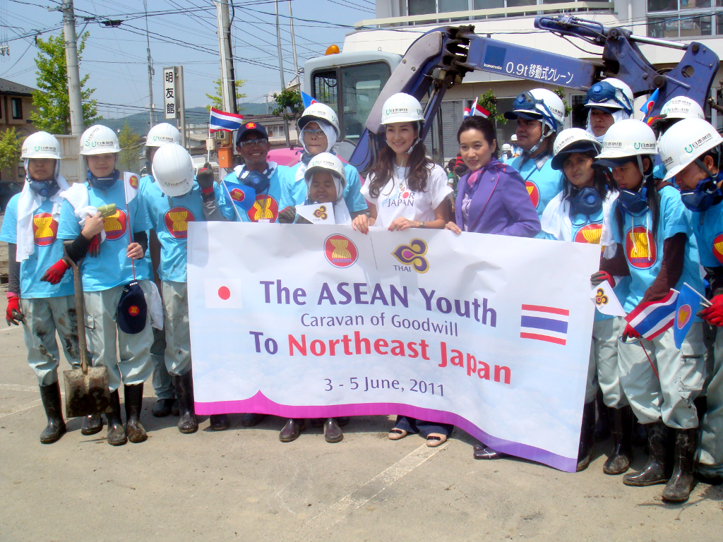Filipino students Norel Palima and Aira Palima (left and second from left) with other participants of the ASEAN Youth Caravan of Goodwill after clearing debris caused by the March 11, 2011 earthquake. (Photo courtesy of Philippine Embassy, Tokyo.)