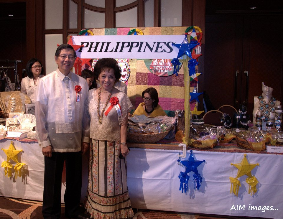 Ambassador Manuel M. Lopez and Madame Lopez in front of Philippine handicrafts booth.