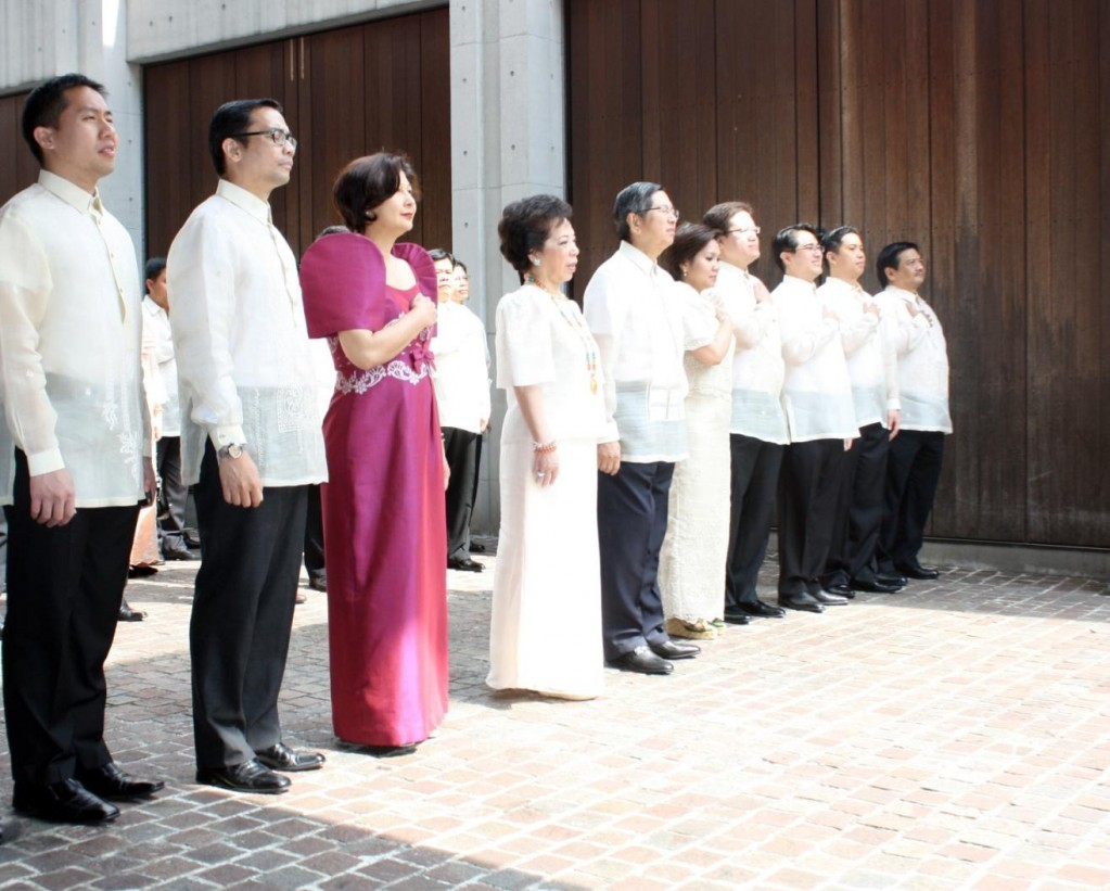 Ambassador and Madame Lopez  lead the Embassy officers and staff in singing the national anthem.