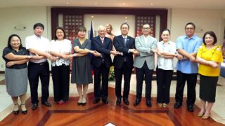 "Embassy officers and Partner Agencies reenacted the ""ASEAN Handshake,"" the traditional handshake of ASEAN leaders"