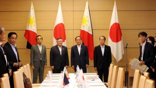 From left to right: Socioeconomic Planning Secretary Ernesto M. Pernia, Finance Secretary Carlos G. Dominguez III, Chief Cabinet Secretary Yoshihide Suga, and Special Adviser to the Prime Minister Dr. Hiroto Izumi