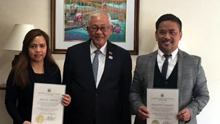 Ambassador Jose C. Laurel V (middle) with Ms. Belen M. Furuta and Mr. Orlando E.  Manalo, both Excellent Client Service Awardees of the Year 2017 of the Philippine Embassy in Tokyo.