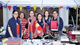 Philippine Embassy personnel wearing Philippine-made Ikat shawls by Chill by Nooks at the handicrafts booth.  (Photo Credit: Ms. Meyen Rabanal)