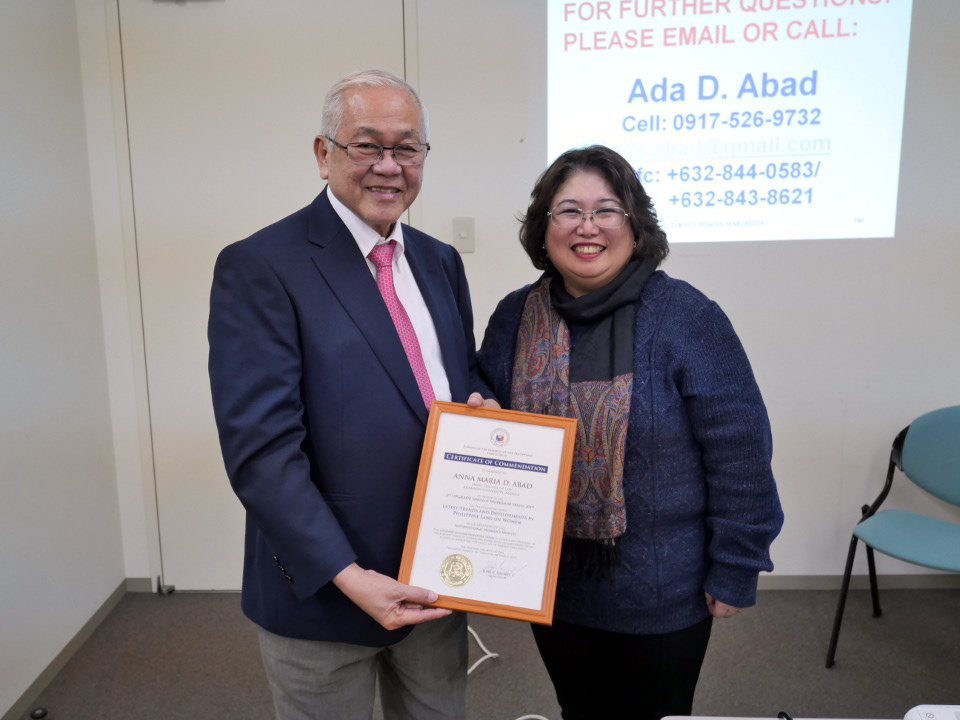 Ambassador Laurel presents a Certificate of Commendation to Atty. Abad.