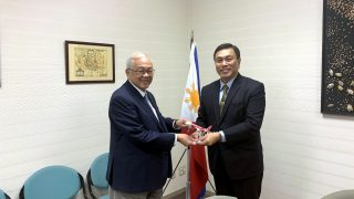 Air Asia Philippines President and CEO Captain Dexter M. Comendador presents a model A 320 airplane to Ambassador Laurel.