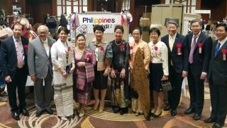 ASEAN Ambassadors with their spouses pose by the Philippine booth at the ALFS Bazaar.
