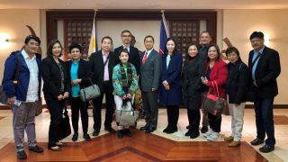 Deputy Chief of Mission Eduardo M.R. Meñez (center) poses with Makati City barangay officials and Asian Institute of Management officials at the Philippine Embassy in Tokyo, Japan.
